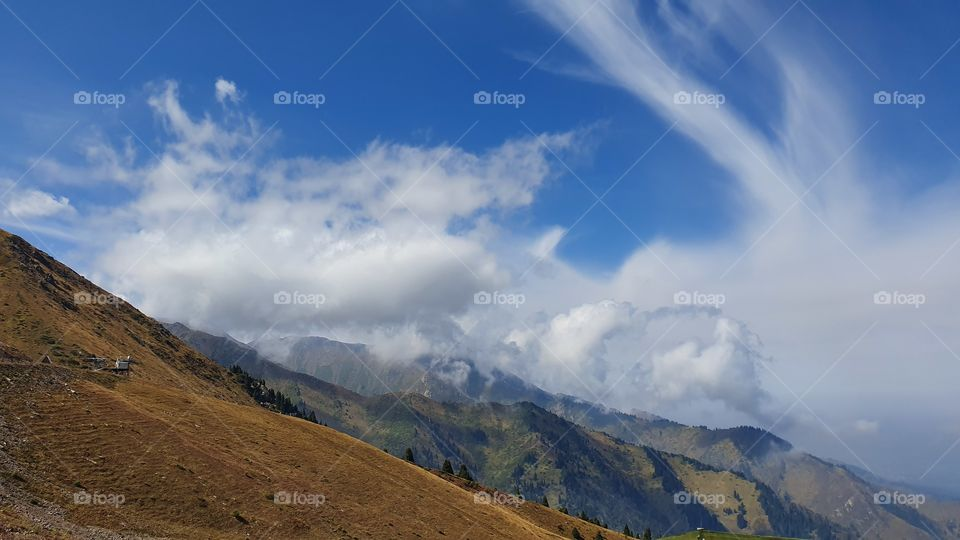Almaty mountains peaks and clouds