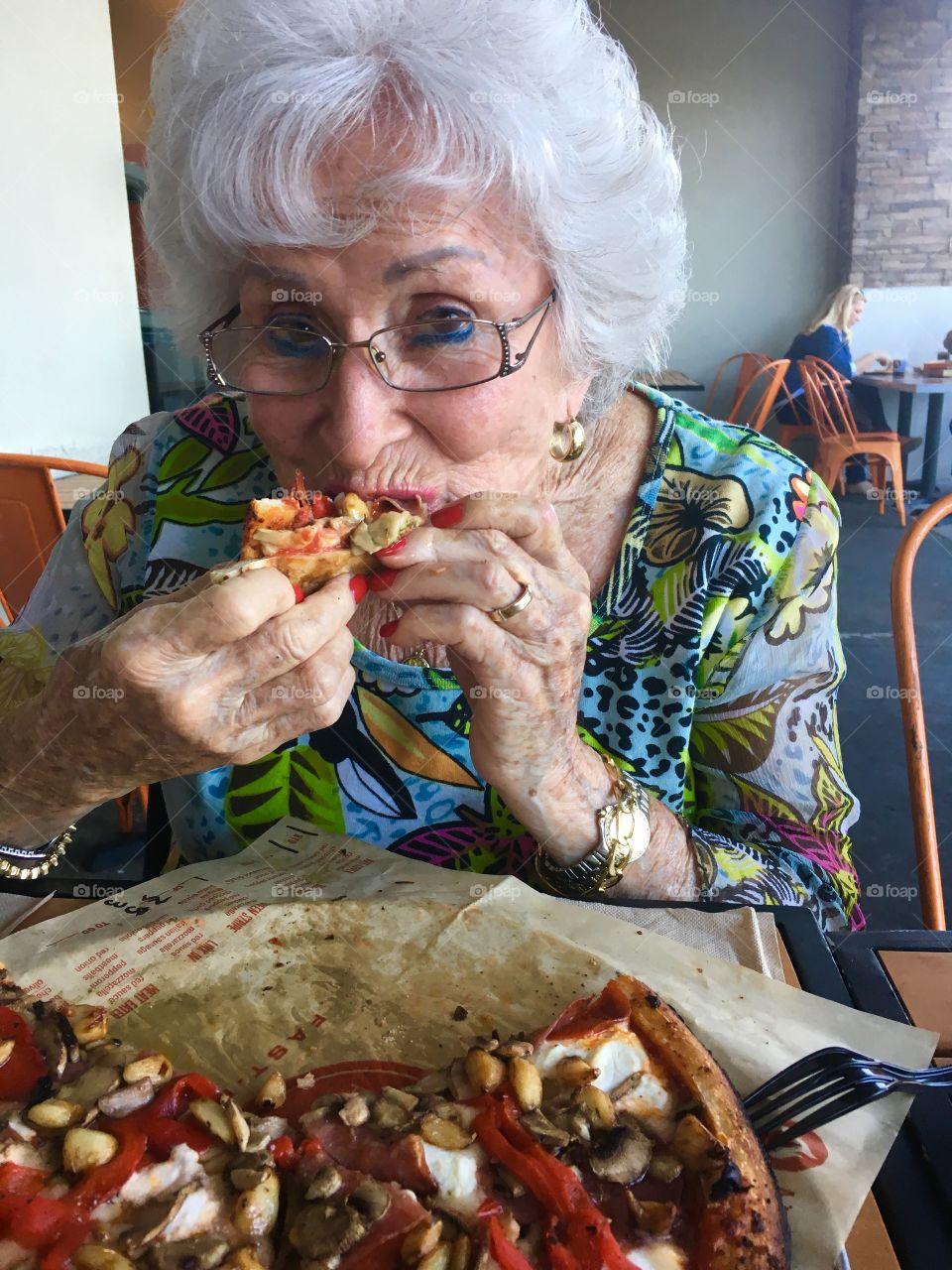 Great grandma eating pizza