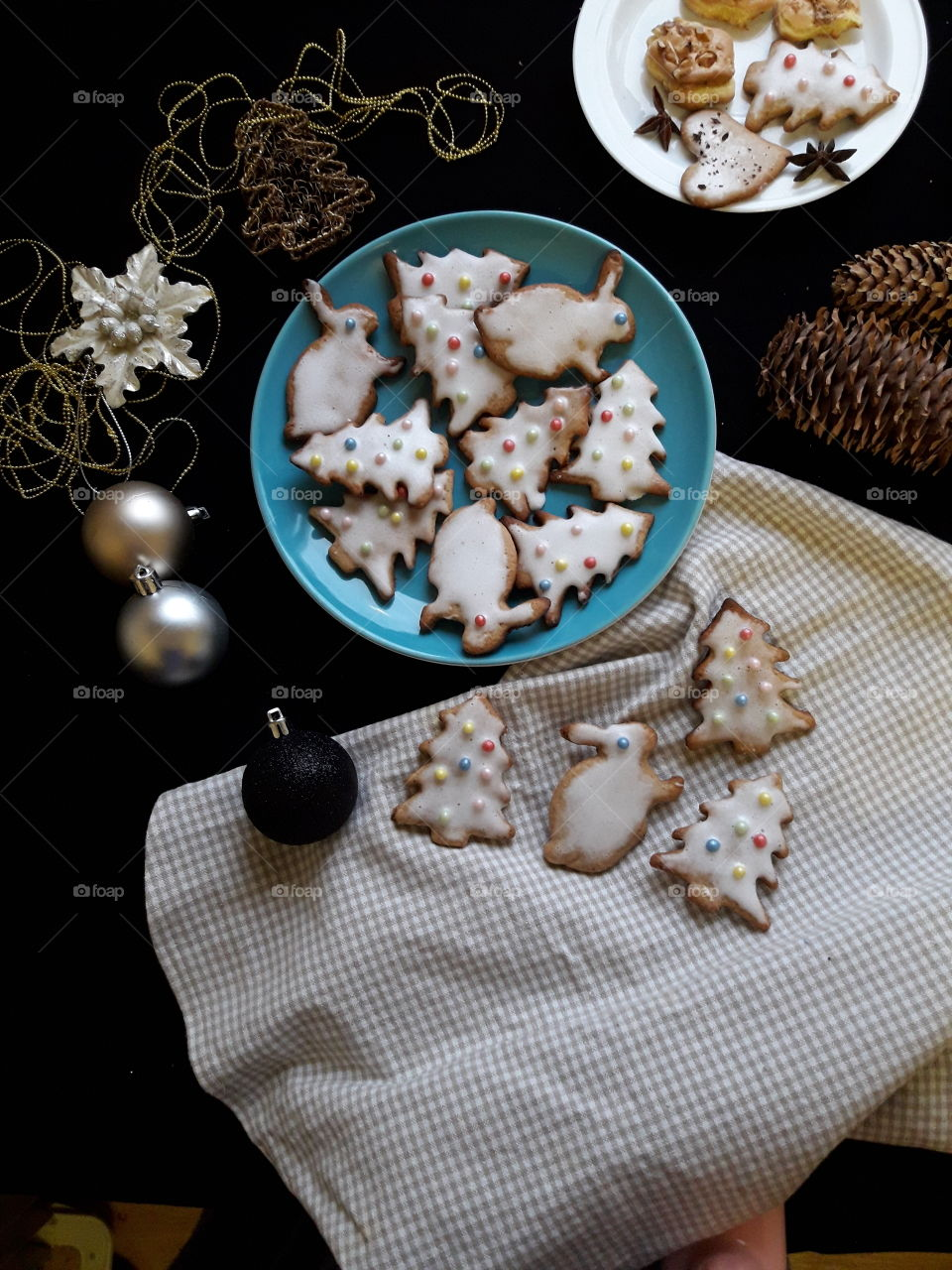Home made Christmas cookies with blue plate on black table