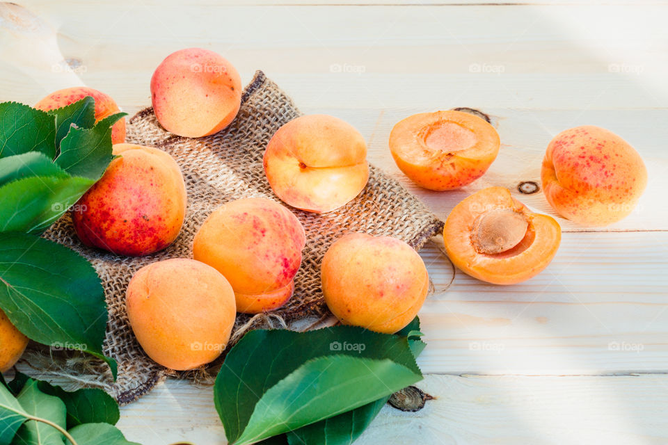 Fresh apricots picked straight from tree in the garden put on wooden table