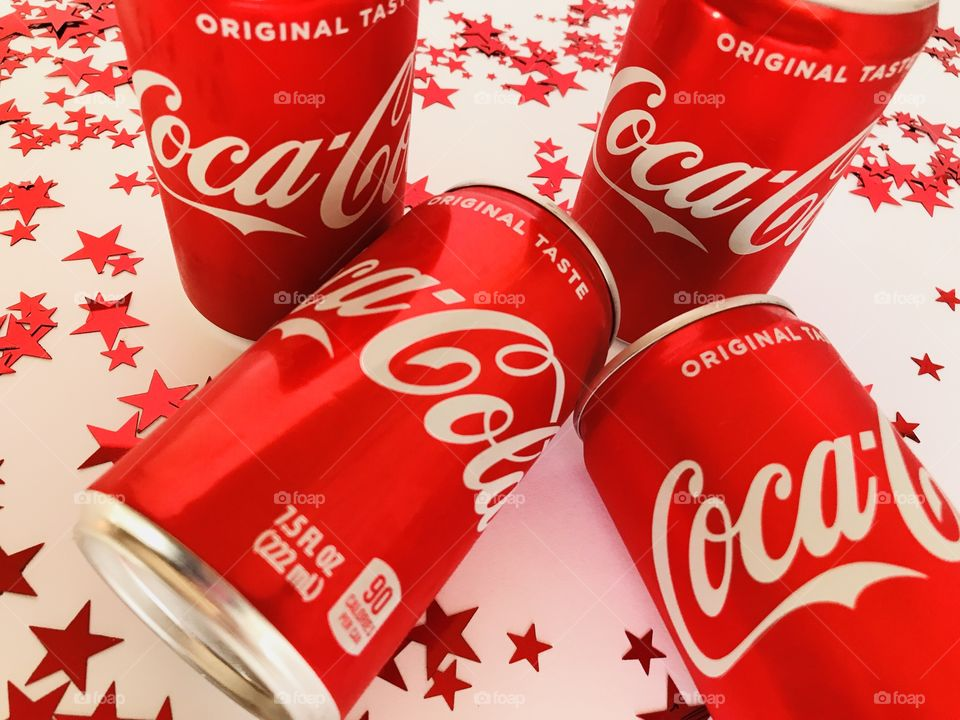 Coca Cola on a white background with red stars