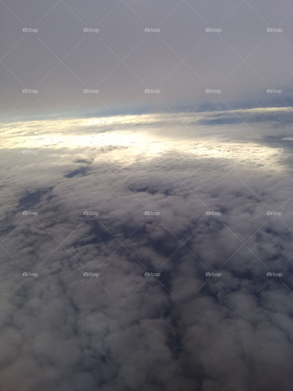 Over the clouds. Photo taken from the airplane.