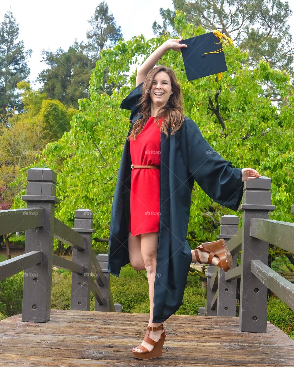 Happy woman with graduation gown and hat