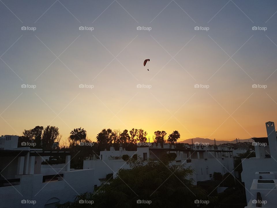 Parasailer who has a better view of the sunset than me.
