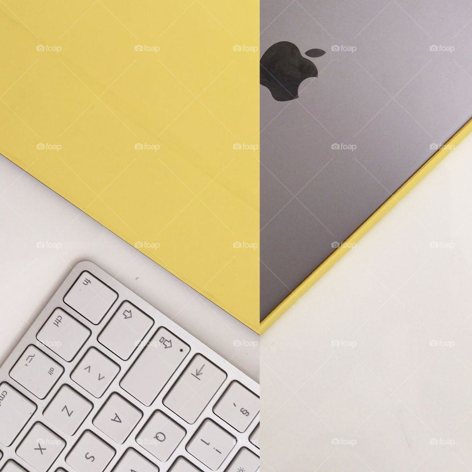 Think different . A composition of a space grey iPad and the very unusual yellow iPad smart cover.