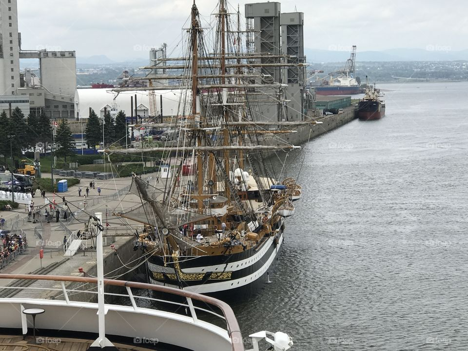 An Antique Ship At Port In Quebec