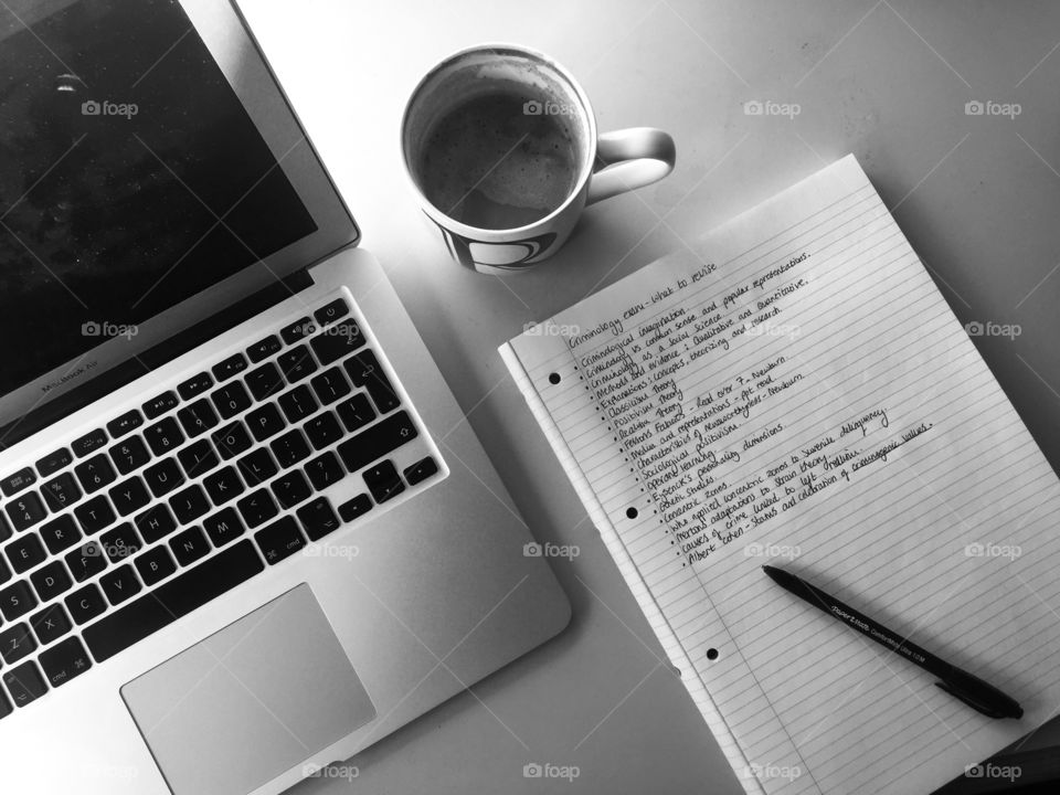 Elevated view of laptop with notebook and coffee cup