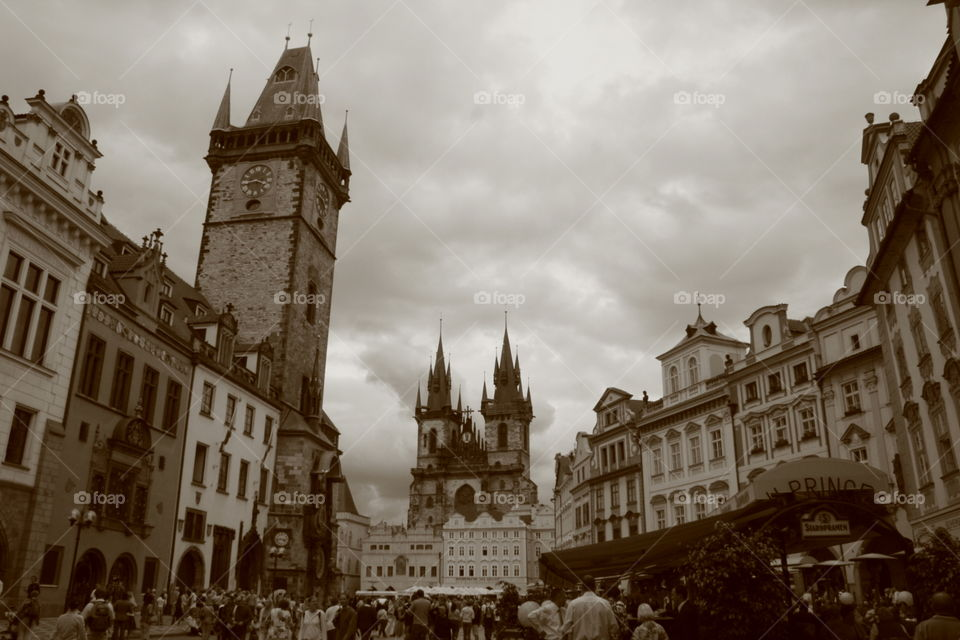 Prague Townhall and Tyn church in black and white on a cloudy afternoon.