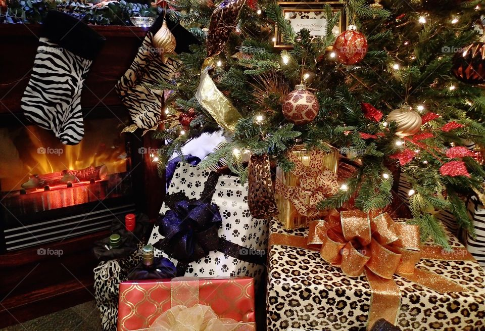 Wrapped presents beneath a beautifully decorated Christmas tree for the holiday season.