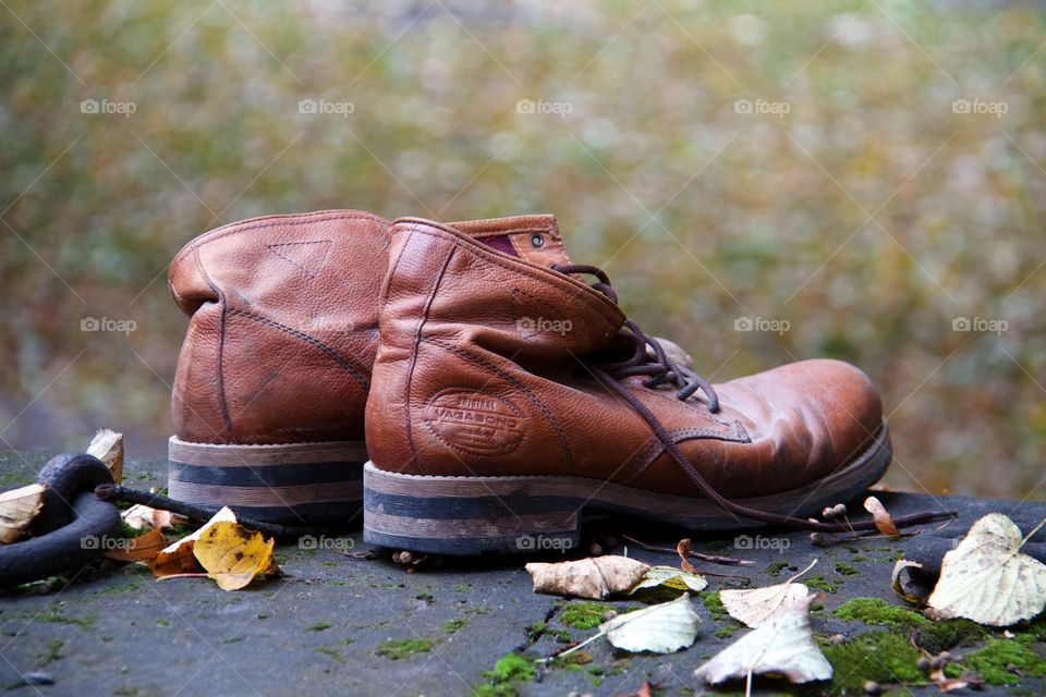 Boots and autumn background