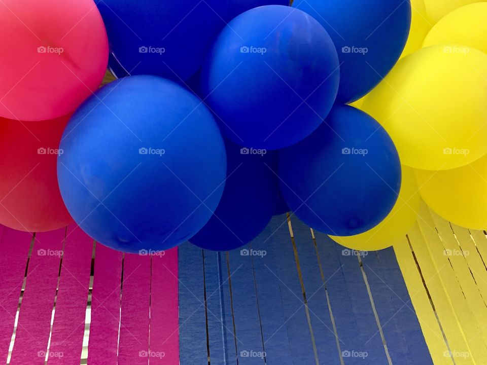 Crepe paper curtain and colorful balloons