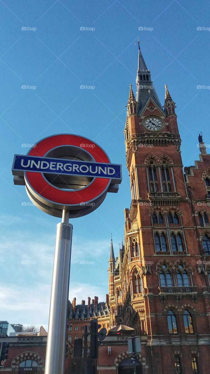 A London Underground sign next to The St Pancras International Renaissance Hotel in Kings Cross, London.