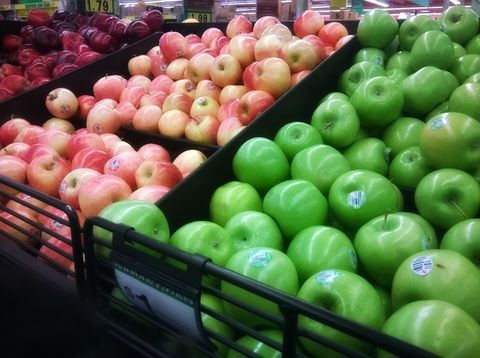 Variety of apples in market stall