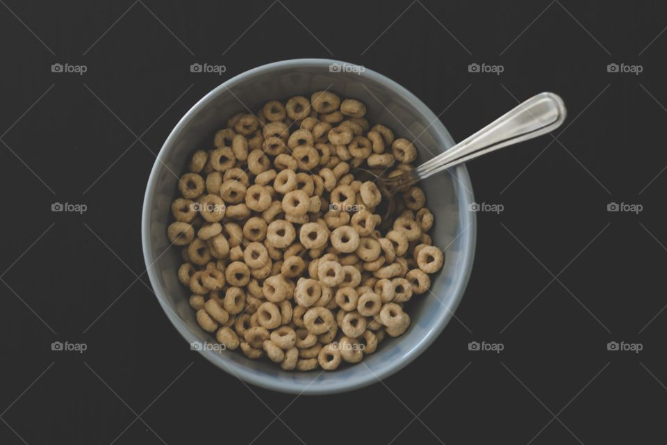 Bowl of cereal with spoon Cheerios