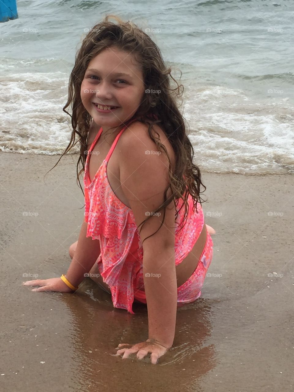 Pretty young girl relaxing in the waves.