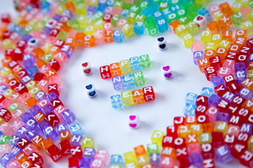 Multi colored block shape letters