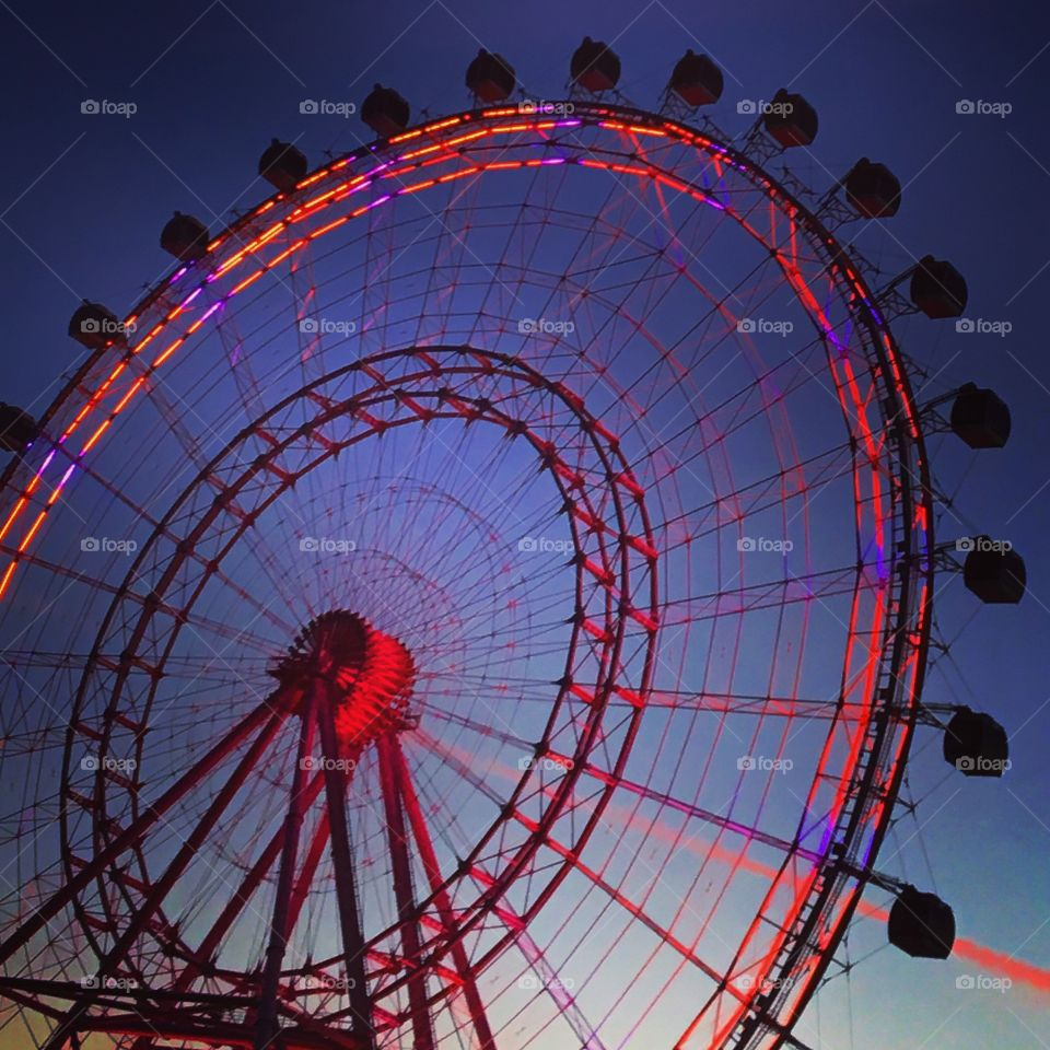Electric ferris wheel Orlando. Made my boyfriend turn around to catch this amazing shot of the colors from sunset and the colors coming to life