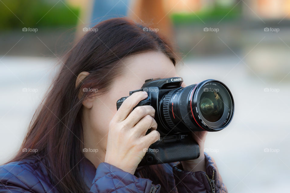 Roman photographer with camera