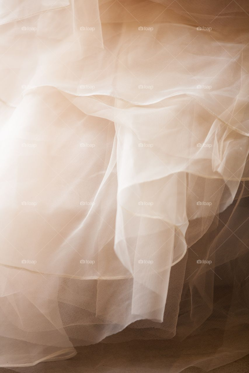 Ruffled tulle of a dress