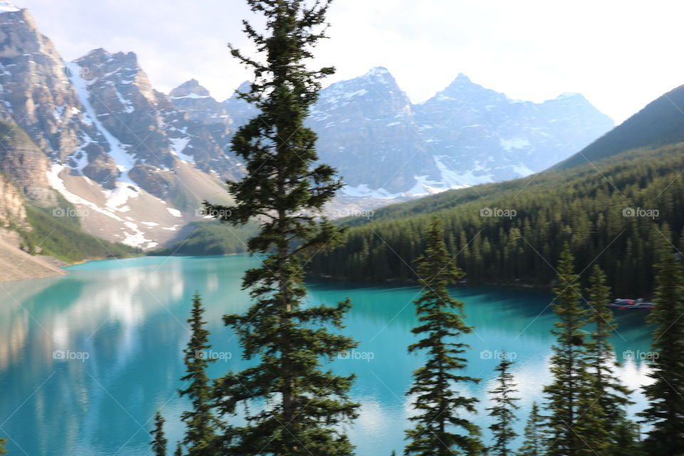 The turquoise lake Luise surrounded with Rocky mountains and woods .. Glaciers from the mountain mirroring into the water making the scenery a natural art. A must see ...