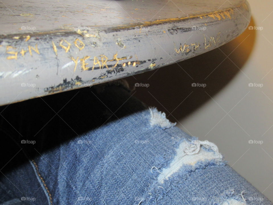 The table was a find from a thrift shop. Jeans are distressed; aren't we all?