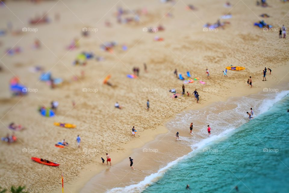 Beach Activites. A busy beach full of holidaymakers having fun and keeping active and healthy. Birds eye view.