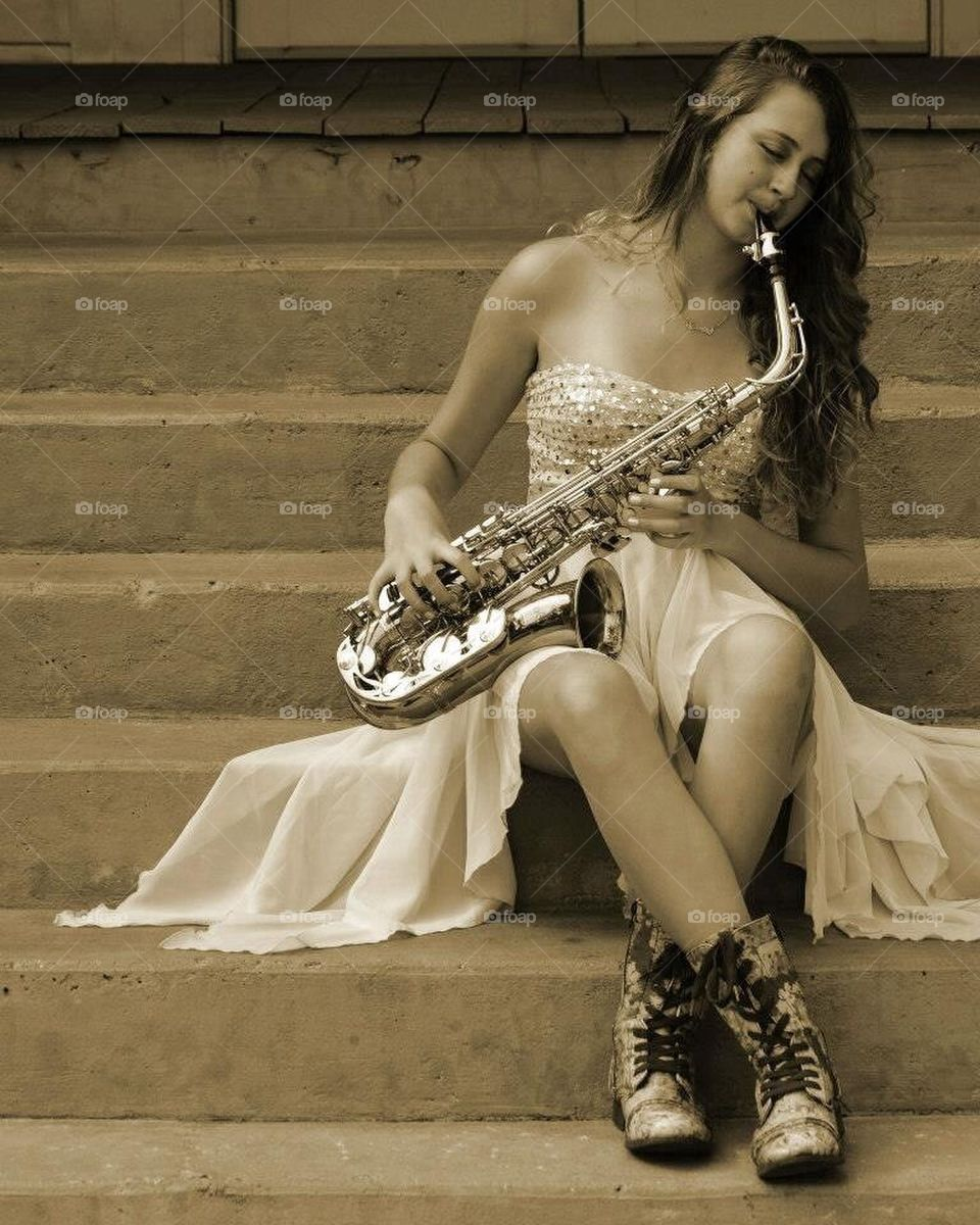 Young lady playing the sax