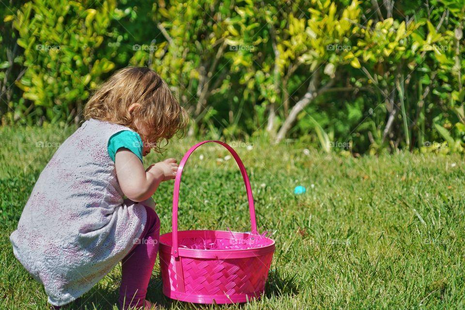 Toddler Girl With Pink Easter Basket