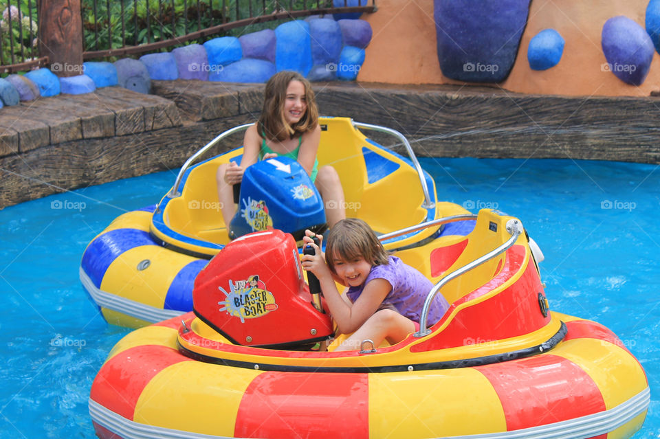 Summertime is for amusement parks! Two of my girls are shown here riding the squirting bumper boats! It was a really hot day so none of us minded getting wet. The water could squirt outside of the pool so even the bystanders, like Mom, got wet! 💦