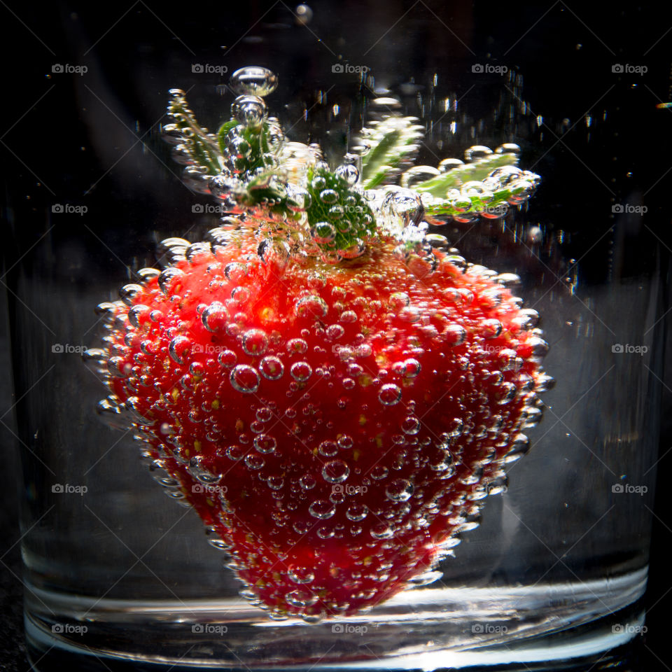 Strawberry in Soda Water with Bubbles