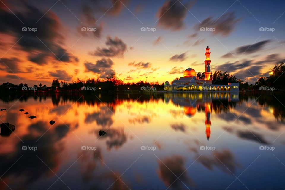 Magical Reflections. Sunset reflections of Kuala Ibai Floating Mosque during golden hour