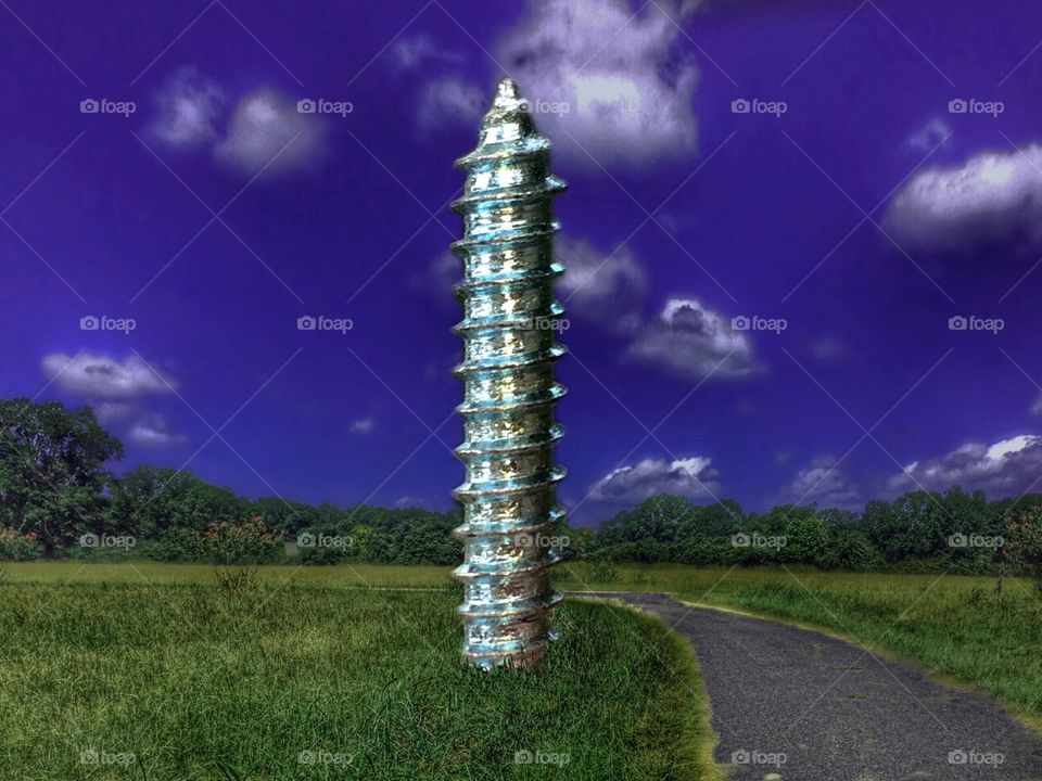 Column sculpture on field