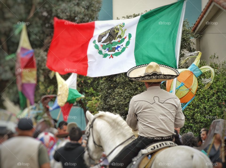 Mexican Pride. Fiesta With Vaquero Displaying Mexican Flag