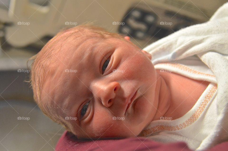 Portrait of tiny newborn baby