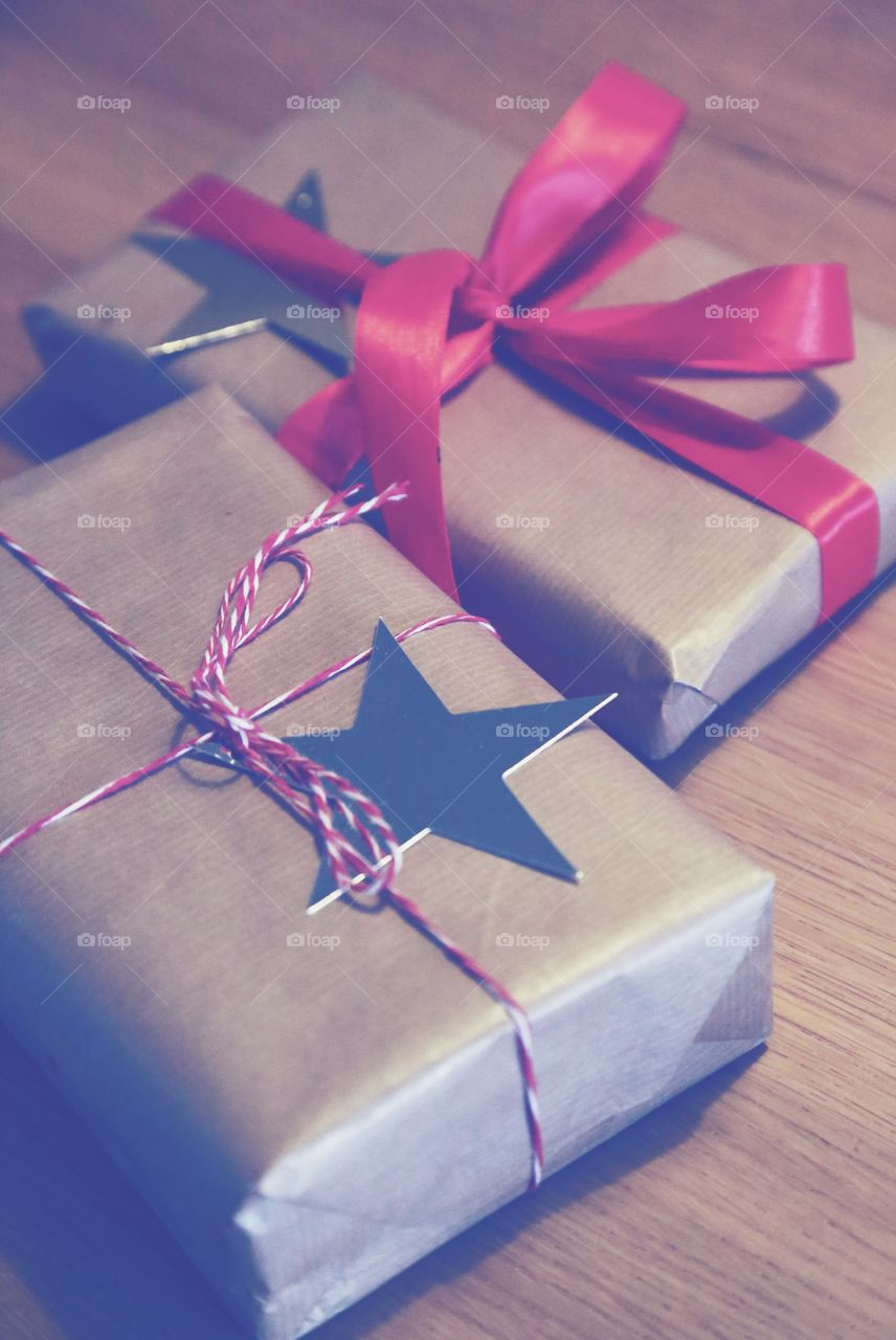 Two wrapped Christmas gifts