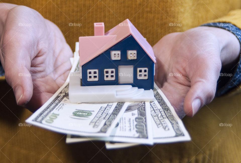 Keys, money, house in hands