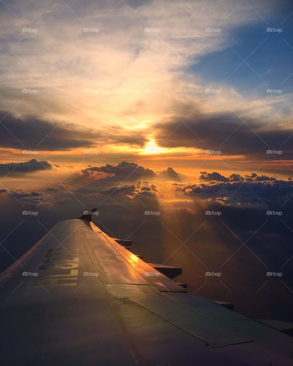 sunset view inside of airplane ✈