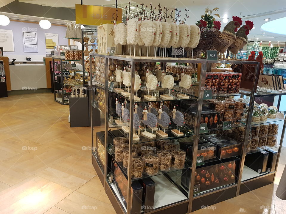 Christmas decorations display on shelves at Peter Jones department store Sloane square Chelsea Kings road London shop
