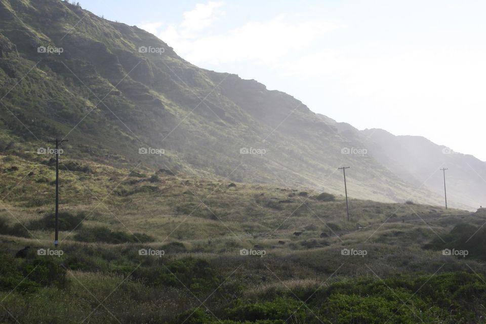 Telephone Poles Fade Away. Telephone poles fade into the distance along a trail that leads to Kaena Point on Oahu, Hawaii.