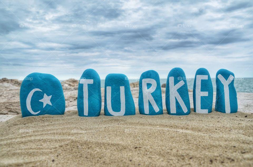 Turkey nation on turquoise painted stones