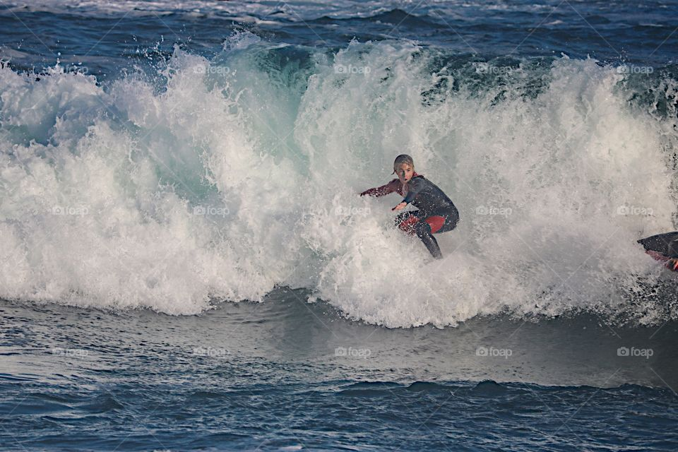 Surfer riding a big wave at The Wedge, Newport Beach, CA