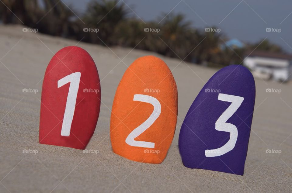 One, two, three or 123 numbers on colourful stones