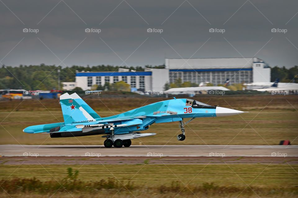 Sukhoi Su-34 Fullback take-off. A fully armed with weapons Russian air force strike fighter Su-34 Fullback  is taking off from runway.