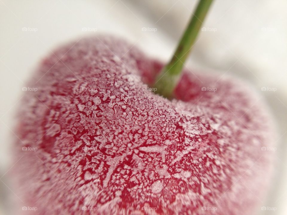 Close-up of a frozen cherry
