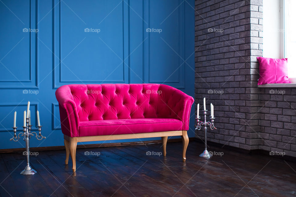 Empty pink sofa at indoors