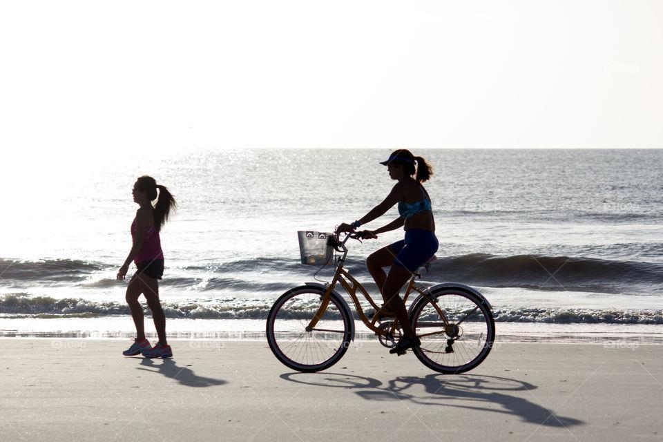 Woman on Bike at Beach