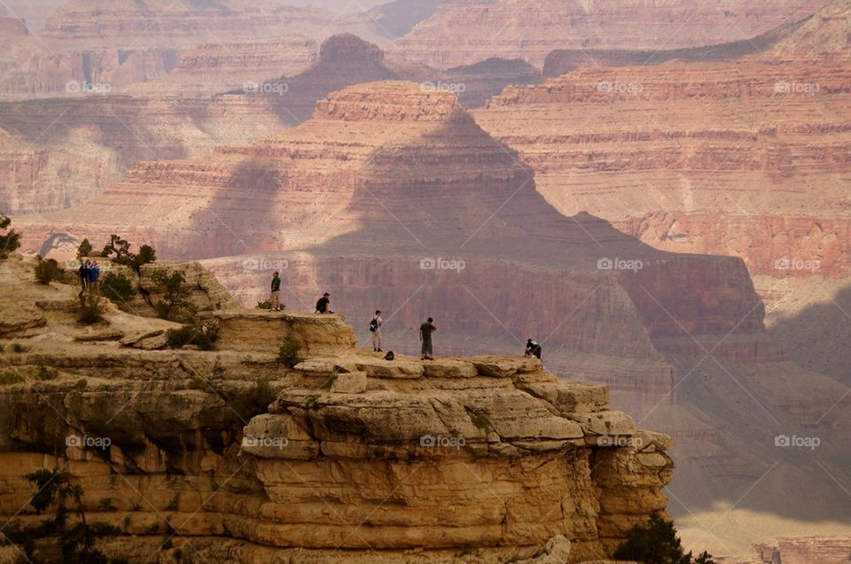 People standing on the cliff