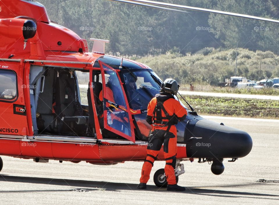 Coast Guard Helicopter And Flight Crew