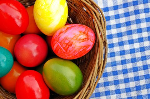 Colorful easter eggs in wicker basket