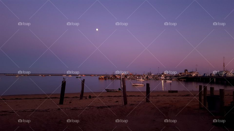 sunset with a bright moon in Provincetown, MA Capecod